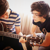 letsgofriday: Louis playing guitar, Harry watching (one direction: harry & louis w/ guitar)