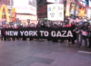 "ajnabieh: Protesters in Times Square, holding a banner reading ""New York To Gaza"" in front of a neon McDonalds. (gaza)"