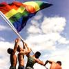 harbek: Men raising rainbow flag (LGBTQA pride flag)