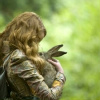 words_unravel: live action shot of alice holding a hare (Alice & the Hare)