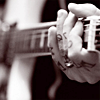 words_unravel: closeup of frank's hand on his guitar (hallo)