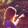 darwin: a girl standing in front of trees, sun caught in her hair (outdoors)