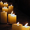 avalanche: Row of yellow lit candles in a dark room. Nostalgy, melancholy, missing, reminiscing. (Vampy>> Thoughts)