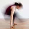 rydra_wong: a yoga practitioner does a jump through, the motion turning into a blur (yoga -- jump through)