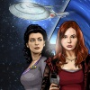 beatrice_otter: Counselor Troi and Amy Pond, with the Enterprise-D in the background. (Crossover--Troi and Pond)