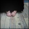 auburn: bare feet on gray boards (Shy Feet)