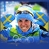 isagel: Skier Charlotte Kalla, having just won Olympic gold, smiling and waving. The palms of her mittens are Swedish flags. (swedishness (charlotte kalla))
