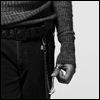 scantling: man in sweater and jeans, making fist next to wallet chain (and dangerous)