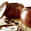 hikarunogo: two bowls holding go stones on a go board (Default)