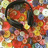 starlady: headphones on top of colorful buttons (music (makes the people))
