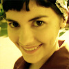 sasha_feather: Amelie, white woman with dark hair, smiling cheerfully (Amelie)