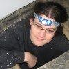 crazyscot: Me climbing through the house manhole. C says I look very zen. (manhole2012)