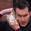 ext_41651: Ianto shiny with mobile (trailer pic)