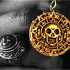 "watersword: closeup of the ""Aztec"" coin from Pirates of the Caribbean: Curse of the Black Pearl (2004) (Pirates of the Caribbean: Aztec gold)"