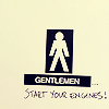 "orm: the text ""START YOUR ENGINES"" graffiti'd onto the sign on a men's toilet (GENTLEMEN: graffiti)"