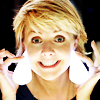 dmarley: Amanda Tapping grinning like a loon, with lit light bulbs for earrings (SG1: Amanda Tapping Lights)
