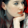 metonymy: Anna Popplewell with her chin in one hand, face in profile. (susan: chin)