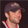 monopoli: cam ward smiling and wearing a black hat and shirt (Default)