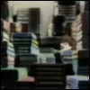 lidabet: tiny girl almost hidden by by giant stacks of books (books!)
