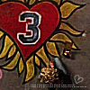 shopfront: Source: One Tree Hill. Peyton, drawing a giant heart on the ground, sitting. (OTH - peyton's arte)