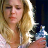 shopfront: Source: Grey's Anatomy. Izzie, holding a bottle of alcohol away from someone, mid-complaint. (GA - hey hands off my shiny)