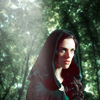 shopfront: Source: Merlin. Morgana in the woods, a hood over he head. (M - [Morgana] magic and destiny)