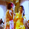 shopfront: Source: Gossip Girl. Vanessa and Blair dressed up, standing in the middle of a party, smiling and talking. (xoxo - [B/V] meeting on common ground)