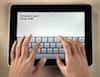 egret: hands typing on an iPad (ipad writing)