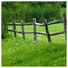beautifulsheen: A wooden picket fence in a brilliantly green field in front a similar colored woods (Fence and field)