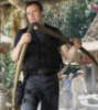 wanted_a_pony: photo of Rodney McKay from Stargate: Atlantis leaning on a large sythe (McKay thigh-holstered with sythe)