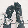 we: A close-up of someone wearing Victorian-style lace-up boots with thick grey stockings. (Lilly - Boots)