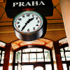 """aella_irene: A picture of the station clock at prague, with a sign saying """"Praha"""" above it (prague: station)"""