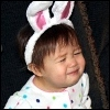 kate_nepveu: toddler sad to be wearing bunny ears (SteelyKid - comically sad (2010-02))