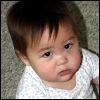 kate_nepveu: toddler sitting in floor looking up (SteelyKid - seriously?! (2009-09))