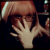 metron_ariston: Garcia is pushing her glasses up her nose so as to creep more better. (Default)