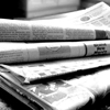 thewritersherald: black and white photo of several newspapers stacked on top of each other (Default)