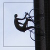 el_staplador: Willow sculpture of a cyclist riding up a fire tower (cycling)