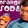 "laughingrat: Leonard McCoy holding up a glass of orange liquid, captioned ""Orange Soda."" (Orange Soda!)"