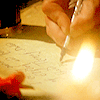 annariel: A Pictureo of a hand writing by candlelight. (Avengers UK)