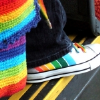 rising: a picture of rainbow looking converse on someone's feet (the cadre: rainbow shoes)