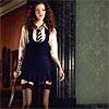 amaresu: Annabell standing in hall with hockey stick (sttrinians-annabel)