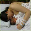 psocoptera: photo of me in hospital bed with newborn baby (newborn)