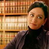 littlemousling: Photo of Kalinda, character from The Good Wife, in front of books of statutes (law)