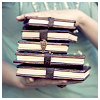 remix_tree: a small stack of books being held between two hands (books)