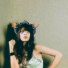 ardhra: Natasha Khan of Bat for Lashes, with a headdress looking upwards (look)