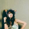 ardhra: Natasha Khan of Bat for Lashes, with a headdress looking upwards (look)