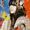 ardhra: Natasha Khan of Bat for Lashes, with a feather fascinator in her hair and a colourful drape (tea)