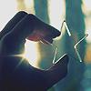 the_coffee_shop: A dark hand holding a metal star against sunlight. (sylvyrr)