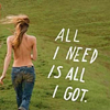 "the_coffee_shop: A topless woman seen from the back, wearing only jeans and her long blonde hair.  Text reads ""All I need is all I got."" (tyssne)"