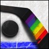jedusaur: A hockey stick with the paddle wrapped in rainbow-colored tape next to a puck, lying just above the blue line on a rink. (no fluff)